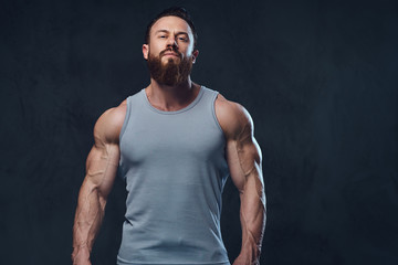 Bearded bodybuilder dressed in a tank top.