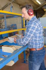 Man using wood working machine