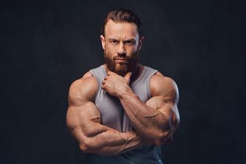 Bearded bodybuilder dressed in a tank top.