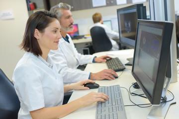 Female technician using computer