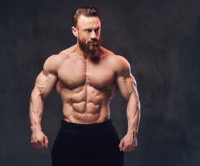 Portrait of bearded shirtless bodybuilder.