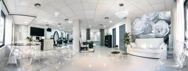 Panoramic view of a modern bright beauty salon. Hair salon and pedicure interior business Wall mural