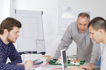 mature teacher and students in computer lab classroom