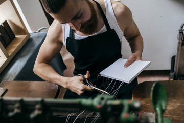 Worker binding paper sheets