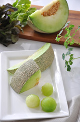 Pieces of Green Melon and Melon Ball Serve on White plate