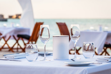 Beautiful table set up for a dinner on the beach