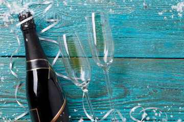 Picture of two wineglasses, bottle of champagne, white ribbons,