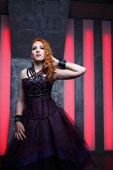 Mystical image of ginger girl in black dress