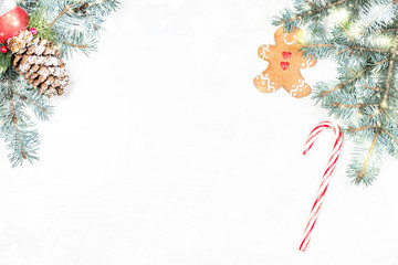 Christmas background with holiday decoration elements and fir tree branches on white wooden background. Christmas Flat lay  and top view composition with border and empty copy space .