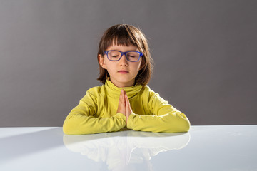 preschooler yoga kid relaxing with mindfulness and calm at school