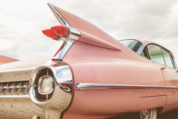 Wall Murals Vintage cars Rear end of a pink classic car