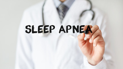 Doctor writing word Sleep Apnea with marker, Medical concept