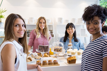 Young women smiling in bakery