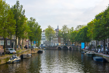 Amsterdam City Center. Beautiful view of Amsterdam Canals with Bridge and typical Dutch Houses. Amsterdam, Netherlands.