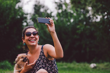 Woman takes a selfie with a dog