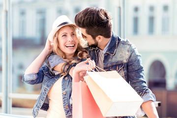 Beautiful couple enjoying shopping together.