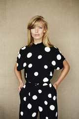 Beautiful blond woman in spotted fashion, portrait