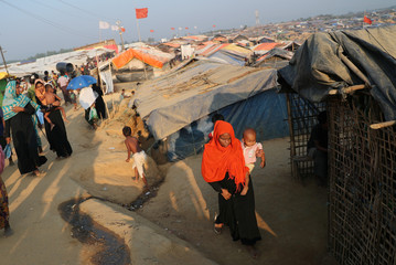 A Rohingya refugee woman walks in the Kutupalong refugee camp in Cox's Bazar