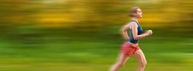 Young sport woman runs very fast. Motion blur on background.