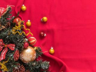 Christmas tree, Christmas balls on a red background. Christmas background. Free space for text. Top view