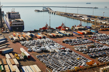 Port terminal with a lot of new cars and containers. Business logistic, Water transport