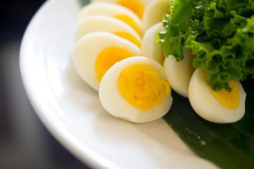 Sliced boiled egg on a white plate