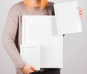 Woman's holding a blank picture frames