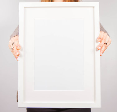 Woman's holding a blank picture frame
