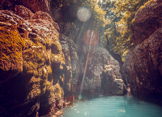 Martvili canyon in Georgia. Beautiful canyon with blue water mountain river. Place to visit. Nature landscape. Travel background. Holiday, rafting, sport, recreation. Vintage retro toning filter