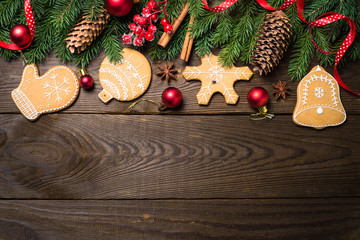 Christmas gingerbread cookies and decorations on dark wooden table. Top view.