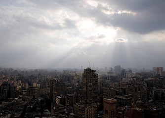 Clouds gather during a rain and cold spell over the capital Cairo
