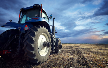 Wall Mural - A powerful tractor handles the ground