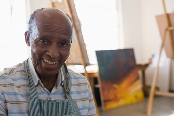 Close up portrait of smiling man in art class