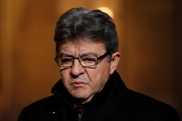 """Jean-Luc Melenchon, leader of Far-left opposition """"France Insoumise"""" (France Unbowed) party, leaves after a meeting at the Elysee Palace in Paris"""