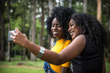 Afro women decent taking selfie photos in the park