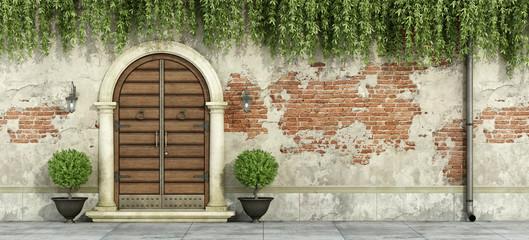 Grunge facade with wooden doorway