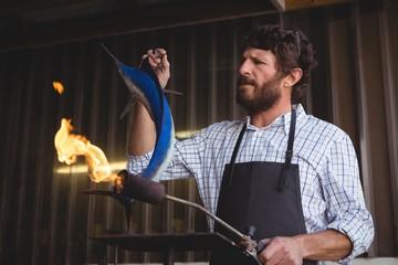 Craftsman preparing fish sculpture