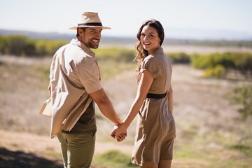 Portrait of smiling couple holding hands