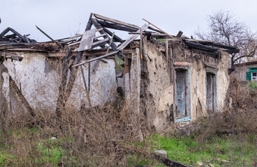 Poverty and unemployment. The walls of the old destroyed house