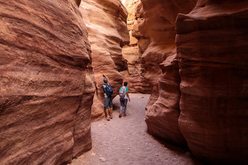 Couple of tourists exploring Red Canyon near Eilat, Israel