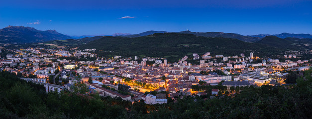 Elevated panoramic view of the City of Gap at twilight. Hautes-Alpes, Southern French Alps, France