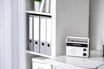 Retro radio on table in room