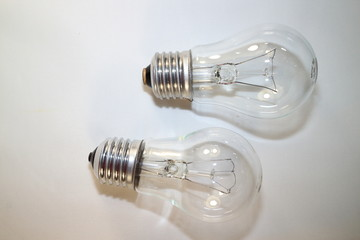 two incandescent lamps close-up on a white background