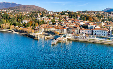 Photo on textile frame City on the water Aerial view of Luino, is a small town on the shore of Lake Maggiore in province of Varese, Italy.