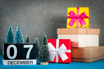 December 7th. Image 7 day of december month, calendar at christmas and new year background with gifts and little Christmas tree