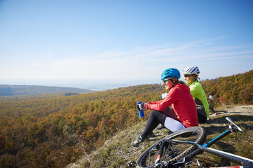 Two female cyclist enjoying the beautiful scenery while out mountain biking.