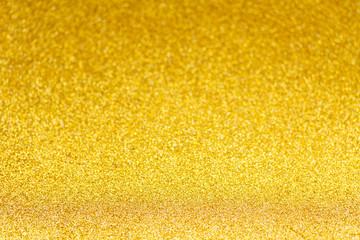 Christmas festives glittering defocused golden background with bokeh