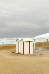 Beach huts at seaside on a winter day, bad weather
