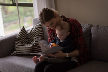 Mother showing picture book to son