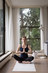 Young woman meditating while sitting at home